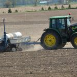 Planter going through a field for seeding